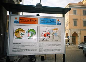 Political Cartoon, public banners, Patras, Greece.